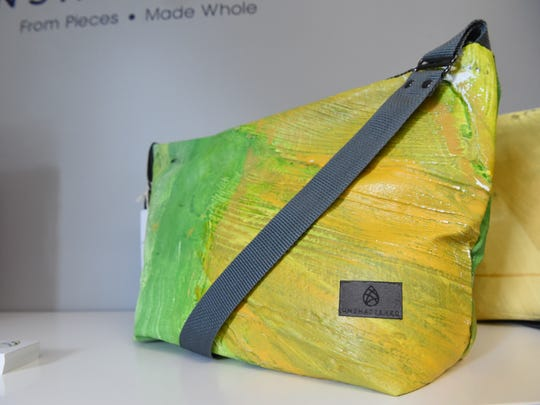 A view of one of the finished bags made at Unshattered. This one was made from recycled materials used in a Broadway show.