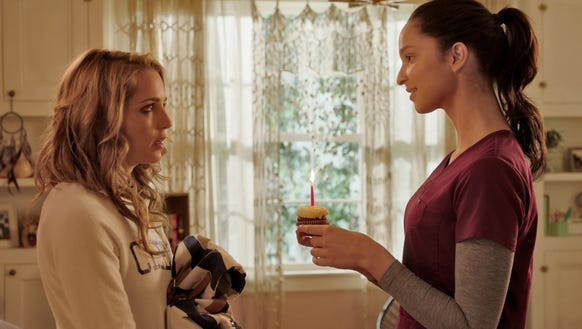 Tree (Jessica Rothe, left) receives a birthday cupcake