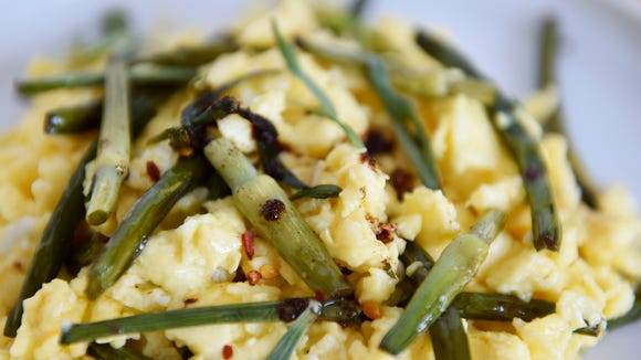 Tarragon-scape scrambled eggs get 'elevated' when they're made with garlic scapes from a CSA share from Prescott's Patch.