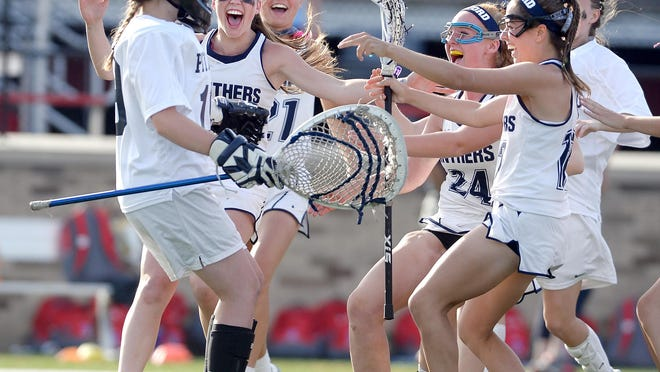 Pittsford players mob goalie Michelle Messenger, left, at the final whistle during the Section V Class A Girls Lacrosse Championship played at St. John Fisher College on Tuesday, May 31, 2016. Pittsford claimed the Class A title with an 11-6 win over Fairport.