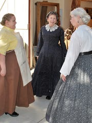 See people dressed in typical Arizona Territorial period