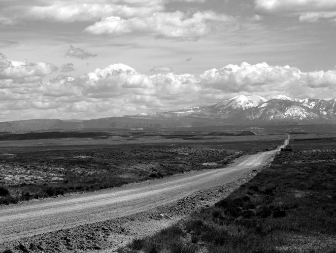 The open road leads drivers to the La Sal Mountains.