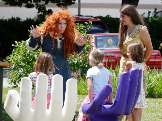 Merida, played by Rachel Thuermer is expressive when describing a story Friday July 8, 2016 at the Above and Beyond Children's Museum.