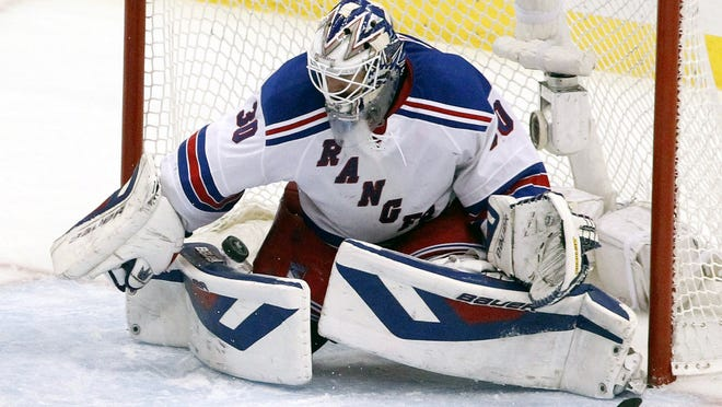 Rangers goalie Henrik Lundqvist makes a save despite losing his stick in the third period of Game 7 Tuesday in Pittsburgh.