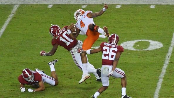 Clemson Tigers quarterback Deshaun Watson (4) is hit