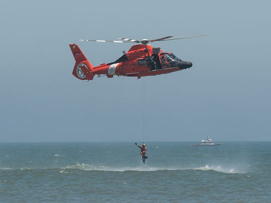 The U.S. Coast Guard performs a search and rescue demonstration during the Ocean City Air Show on Saturday, June 17, 2017.