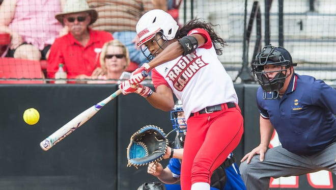 UL shortstop DJ Sanders, shown here pounding her 25th homer of the season, was named as the Hitter of the Year on the LSWA's All-Louisiana softball team.