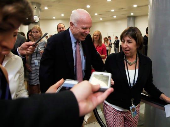 Sen. John McCain, R-Ariz., is surrounded by journalists