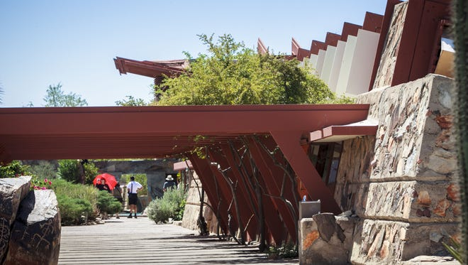 A tour group walks by the drafting studio at Frank Lloyd Wright's Taliesin West.