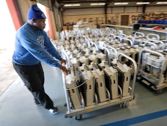 Cortez Triplett with Ewing Moving and Storage moves Shelby County voting machines in 2016.