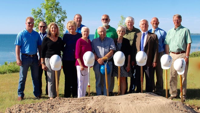 A groundbreaking ceremony for the Spirit of the Rivers monument was recently held on the lakeshore between Manitowoc and Two Rivers at 4815 Memorial Drive. Pictured in first row, from left: Manitowoc Mayor Justin Nickels, Carole Witt Starck, Carol Wergin, Lynn Wallen, artist R.T. Wallen, Judy Goodchild and Two Rivers City Manager Greg Buckley; and second row, from left: Larry Corrado, Paul Steinbrecher, Tom Van Horn, Kerry Trask, Joe Metzen and Steve Hamann.
