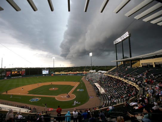 Storm clouds roll in March 25, 2016, over Champion