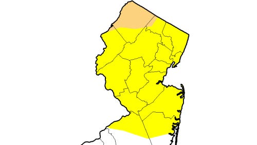 The abnormally dry area is yellow and the brown area is in a moderate drought