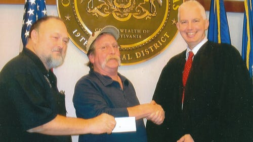 Veterans of the Vietnam War Inc. and the Veterans Coalition, Post 35, of York County, donated $1,000 to the York County Veterans Treatment Court. Pictured at the check presentation are, from left, Mike Depew, past Post Commander, Wayne Loeblein, Post First Vice Commander, and the Honorable Judge Craig T. Trebilcock.
