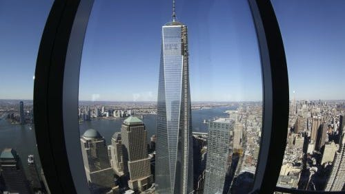 In this Nov. 13, 2013 file photo, 1 World Trade Center, center, is viewed from the 62nd floor of Four World Trade Center in New York. On the thirteenth anniversary of the attacks of Sept. 11, 2001, 1 World Trade Center will soon open to its first tenants and Four World Trade Center is open. (AP Photo/Mark Lennihan, File)