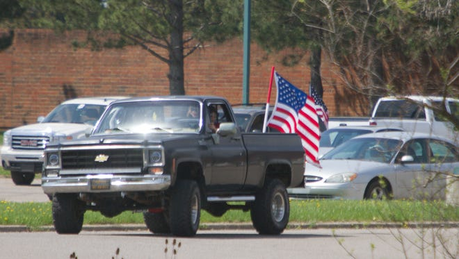 A number of student vehicles were once again sporting flags this week. Last month, school officials told students all flags had to be removed over safety concerns, but some interpreted that to mean the  American flag had been banned from the student parking lot.