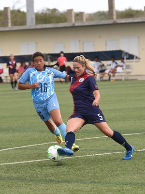 Team Guam's Samantha Drees Kaufman (5) protects the ball against NMI's Angelina Villagomez (16) during the EAFF Women's E-1 Football Championship 2017 Round 1 Guam game at the Guam Football Association National Training Center in Dededo on July 3. Team Guam defeated the Northern Mariana Islands 5-0.