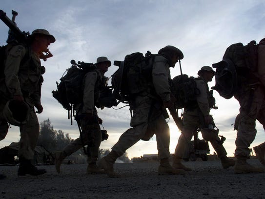 In this Dec. 31, 2001 file picture, Marines with full