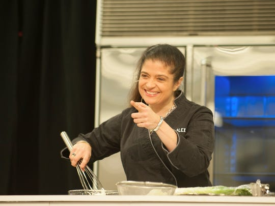 """Chef Alex Guarnaschelli, a judge on the Food Network show """"Chopped,"""" stages a  cooking demonstration at Fantastic Food Fest 2017 at Indiana State Fairgrounds."""