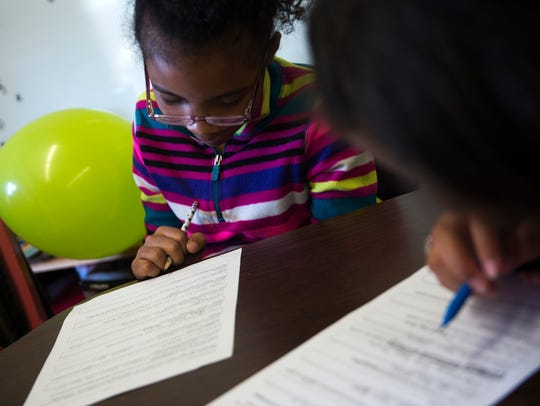 Aaliyah Trent, 9, left, and Jayla Bartolomei, 9, fourth-graders at Fountain City Elementary School, work in a small group with their teacher a week before TNReady standardized tests are administered April 13, 2017.