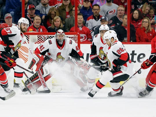 Carolina Hurricanes' Teuvo Teravainen (86), of Finland, and Valentin Zykov (73), of Russia, try to get a shot against Ottawa Senators goalie Craig Anderson (41) as Senators' Ben Harpur (67) and Ben Sexton (26) defend during the first period of an NHL hockey game in Raleigh, N.C., Monday, March 26, 2018. (AP Photo/Gerry Broome)