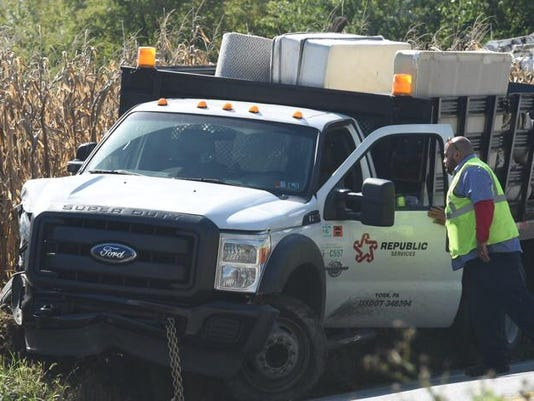A damaged truck at the scene of a struck utility pole on Route 116 at Menges Mills.