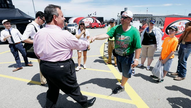 Republican presidential candidate, New Jersey Gov. Chris Christie greets Terry Rudolph, of Wilton, Iowa, right, before the NASCAR Xfinity Series auto race, Saturday, Aug. 1, 2015, at Iowa Speedway in Newton, Iowa.