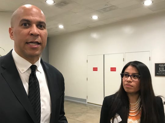 Sen. Cory Booker, D-N.J., with Ridgefield Park resident Elizabeth Vilchis, his guest for the State of the Union speech on Jan. 30, 2018. Vilchis is among about 17,400 undocumented immigrants in New Jersey who have work permits under the Deferred Action for Childhood Arrivals, or DACA, program.