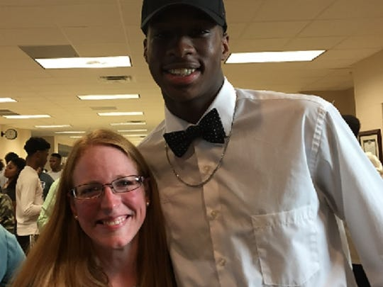 South Carolina signee Israel Mukuamu poses with Parkway math teacher Candace Impson after signing with the Gamecocks Friday afternoon.