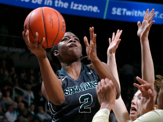Michigan State's Mardrekia Cook (2) goes to the basket