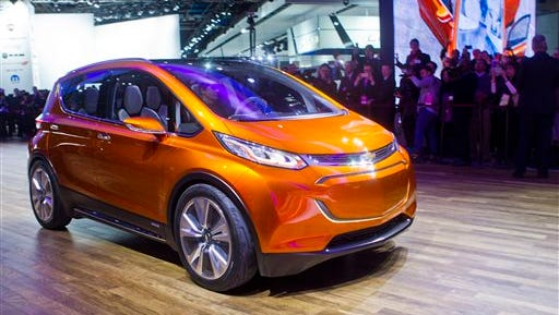 The Chevrolet Bolt EV electric concept vehicle is driven onto the stage at a presentation during the North American International Auto Show, Monday in Detroit.