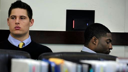 Brandon Vandenburg and Corey Batey wait for court to start during day six of the Vanderbilt rape trial on Monday, Jan. 19, 2015, in Nashville in Tenn. Jurors in the rape trial of two ex-Vanderbilt football players have been shown graphic videos of the alleged attack on the campus. (AP Photo/The Tennessean, John Partipilo)