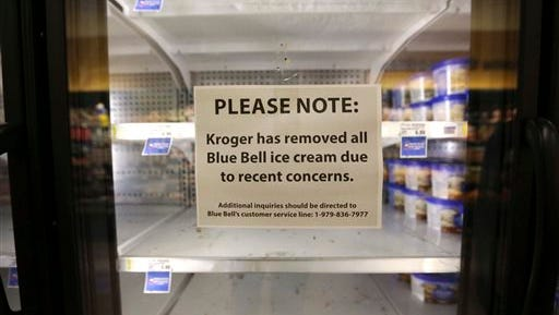 FILE - In this April 21, 2015 file photo, a sign explains why shelves sit empty of Blue Bell ice cream at a grocery store in Dallas. Blue Bell Creameries will lay off more than a third of its workforce following a series of listeria illnesses linked to its ice cream that prompted a nationwide recall, the Texas company announced Friday, May 15, 2015 (AP Photo/LM Otero, File)