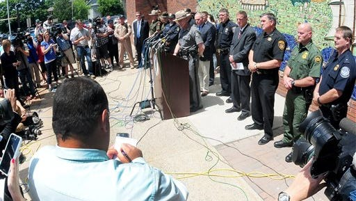 Maj. Charles Guess addresses the media during a news conference, Wednesday, June 17, 2015, in Plattsburgh, N.Y. where he discussed the escape of David Sweat and Richard Matt from the Clinton Correctional Facility in Dannemora, N.Y. The pair escaped from the maximum-security facility 12 days ago. (Rob Fountain/The Press-Republican via AP)