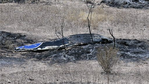 Scattered debris remains on the ground following a plane crash near the town of Ventucopa, Calif., Monday, June 22, 2015. County fire spokesman Mike Lindbery says the crash happened around 9:30 a.m. Monday near Quatal Canyon in Los Padres National Forest. (Mike Eliason/Santa Barbara County Fire Department via AP)