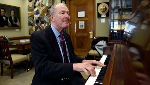 In this May 22 file photo, Sen. Lamar Alexander, R-Tenn., plays piano in his office on Capitol Hill in Washington.