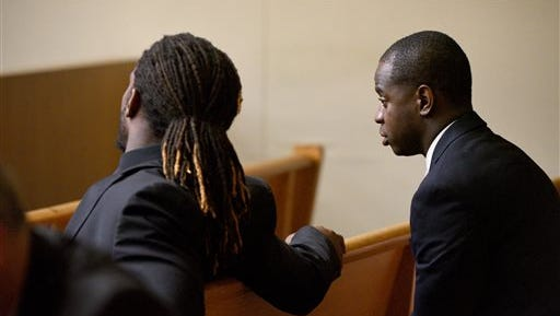 Former University of Tennessee football players Michael Williams, right, and A.J. Johnson talk in court before an earlier trial. Their trial dates have been moved multiple times while defense lawyers attempt to obtain social media communications related to the case.