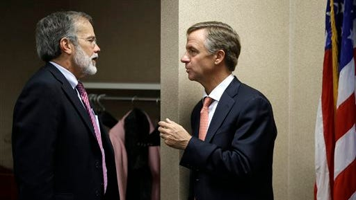 In this Nov. 13, 2012 file photo, Tennessee Gov. Bill Haslam, right, talks with John Morgan, left, chancellor of the Tennessee Board of Regents, during a break in budget hearings in Nashville. Morgan is stepping down as head of the Tennessee Board of Regents amid Haslam's plans to grant more autonomy to the six four-year universities in the system.