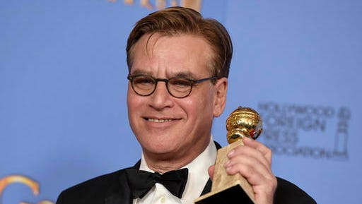 """FILE - In this Jan. 10, 2016, file photo, Aaron Sorkin poses in the press room with the award for best screenplay - motion picture for """"Steve Jobs"""" at the 73rd annual Golden Globe Awards at the Beverly Hilton Hotel in Beverly Hills, Calif. President-elect Donald Trump's victory prompted Sorkin to write a letter to his wife and daughter that was published online by Vanity Fair Nov. 9, 2016."""