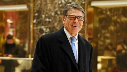 FILE - In this Dec. 12, 2016, file photo, former Texas Gov. Rick Perry smiles as he leaves Trump Tower in New York. President-elect Donald Trump selected Perry to be secretary of energy.