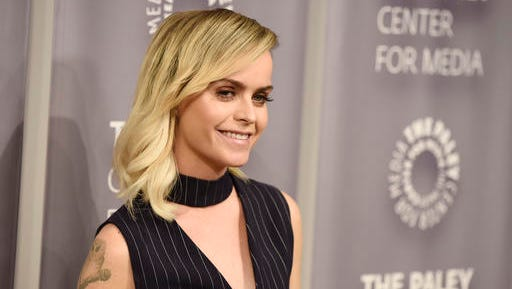 """FILE - In this May 26, 2016, file photo, Taryn Manning, a cast member in the Netflix series """"Orange is the New Black,"""" poses at An Evening with """"Orange is the New Black,"""" at The Paley Center in Beverly Hills, Calif. Manning and Netflix denied a Jan. 18, 2017, In Touch magazine report that the actress had quit the show."""