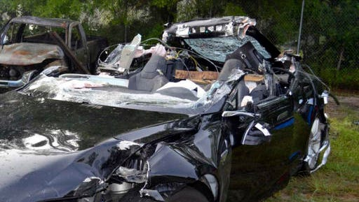 FILE - In this photo provided by the National Transportation Safety Board via the Florida Highway Patrol, a Tesla Model S that was being driven by Joshua Brown, who was killed when the Tesla sedan crashed while in self-driving mode on May 7, 2016. A source tells The Associated Press that U.S. safety regulators are ending an investigation into a fatal crash involving electric car maker Tesla Motors' Autopilot system without a recall. The National Highway Traffic Safety Administration scheduled a call Thursday, Jan. 19, 2017, about the investigation.