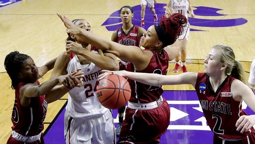 New Mexico State's Brooke Salas, right, steals the ball from Stanford's Erica McCall during the first half of a first-round game in the NCAA women's college basketball tournament Saturday, March 18, 2017, in Manhattan, Kan.