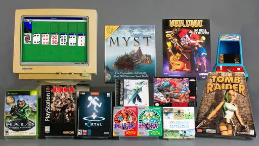 """In this March 16, 2017 photo provided by The Strong museum, the 12 finalists for induction this year into The Strong museum's World Video Game Hall of Fame are pictured at the museum in Rochester, New York. The finalists, from left, are: top row, """"Microsoft Windows Solitaire,"""" """"Myst,"""" """"Mortal Kombat,"""" """"Donkey Kong,'' center, """"Final Fantasy VII,'' """"Street Fighter II,"""" bottom row, ''Halo: Combat Evolved,'' """"Resident Evil,"""" """"Portal,"""" """"Pokemon Red and Green,"""" """"Wii Sports"""" and """"Tomb Raider."""" The 2017 class will be announced May 4."""
