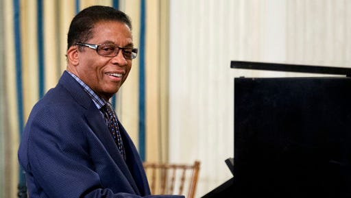 FILE - In this Friday, April 29, 2016, file photo, Musician Herbie Hancock plays to high school students from across the Washington D.C. area in State Dining Room of the White House in Washington, as part of the International Jazz Day celebration. Hancock and Chucho Valdes will be serving as artistic directors for the 6th International Jazz Day. On Monday, April 10, 2017, the United Nations Educational, Scientific and Cultural Organization announced that Havana will be the global host city for the event, culminating with an all-star concert on April 30 at the recently renovated 19th-century Gran Teatro de La Habana.