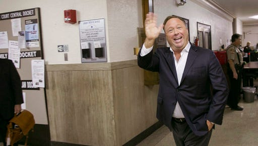 FILE- In this April 19, 2017, file photo, Alex Jones, a well-known Austin-based broadcaster and provocateur, arrives for a child custody trial at the Heman Marion Sweatt Travis County Courthouse in Austin, Texas. Greek yogurt giant Chobani is suing Jones, accusing the conspiracy theorist of publishing false information about the company. Chobani filed the lawsuit Monday, April 24.