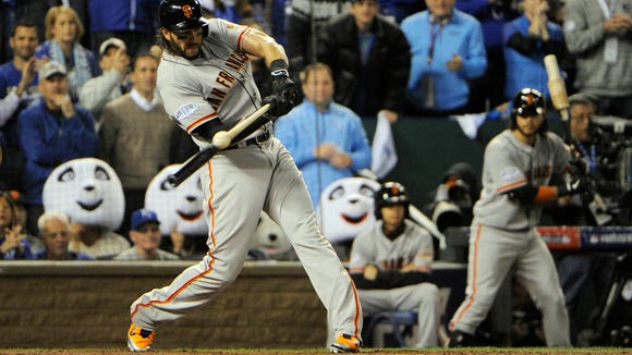 Giants designated hitter Michael Morse hits an RBI single against the Kansas City Royals during Game 7 of the World Series.