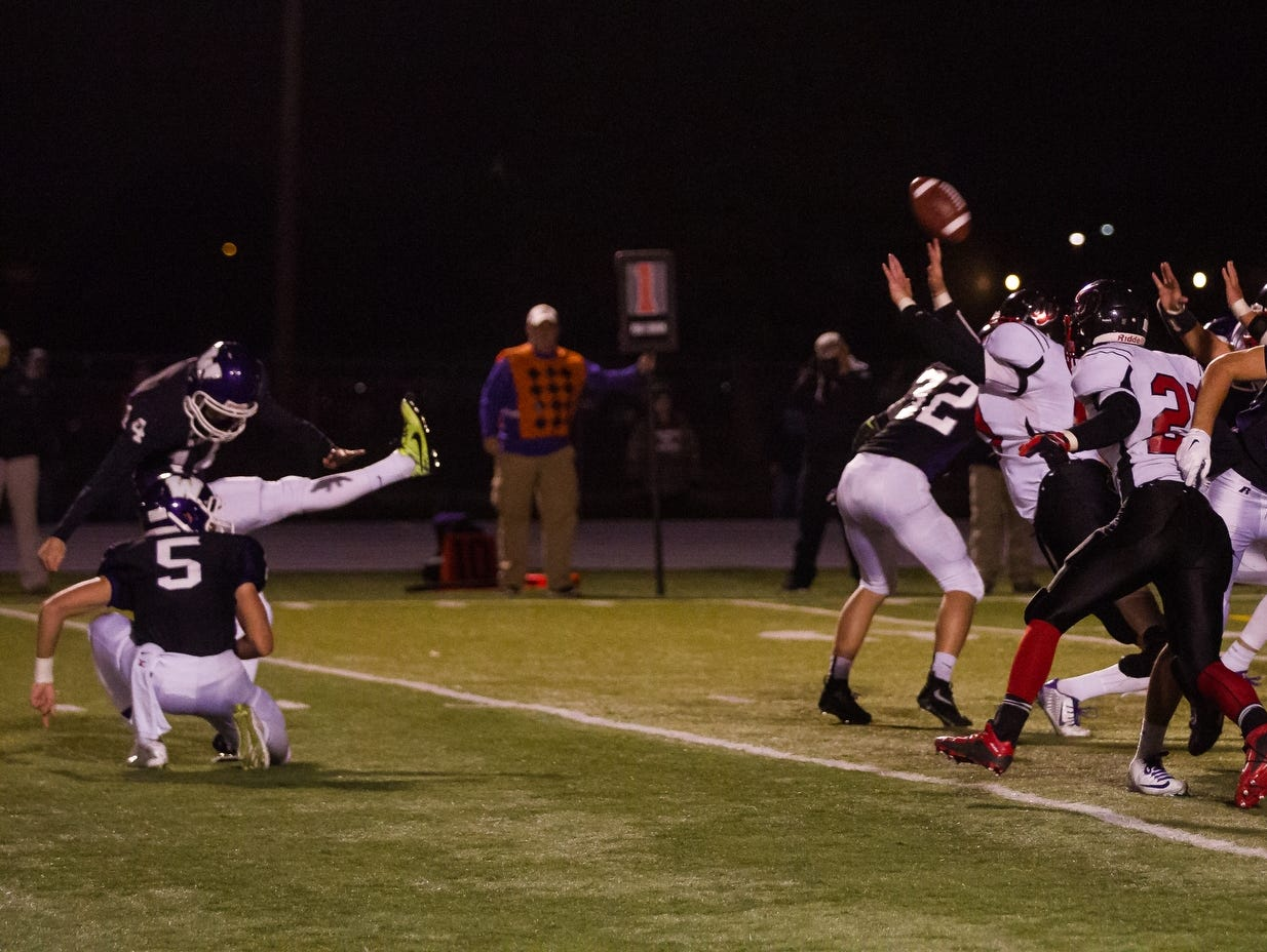 Waukee's Skyler Crew kicks the game winning field goal during their game against Fort Dodge in Waukee on Friday, October 16, 2015. The kick put the Warriors up 31-28.