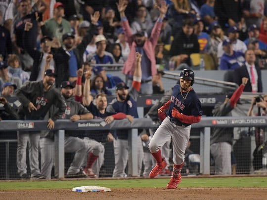 Boston Red Sox's Mookie Betts rounds the bases after a home run during the sixth inning in Game 5 of the World Series  against the Los Angeles Dodgers on Sunday, Oct. 28, 2018, in Los Angeles.