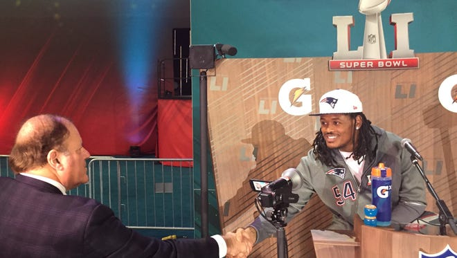 Patriots linebacker Dont'a Hightower, a former Marshall County standout, shakes hands with ESPN's Chris Berman during Opening Night for Super Bowl LI on Monday at Minute Maid Park in Houston.